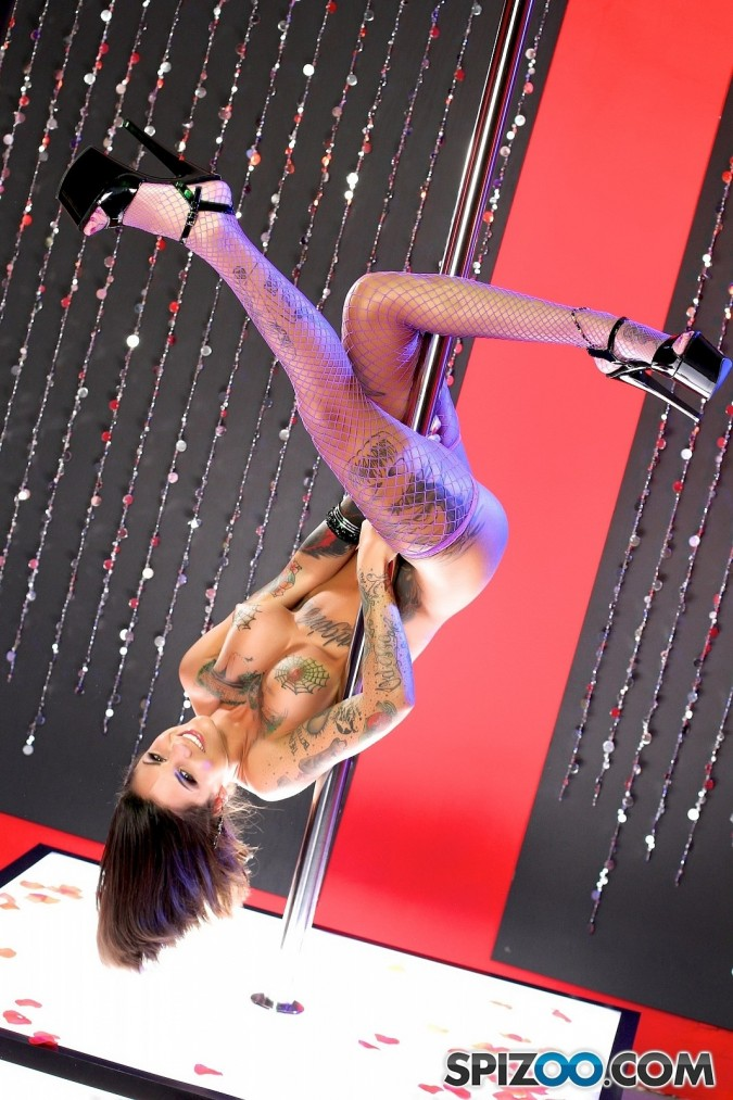 wearing only her fishnets, Bonnie Rotten works the stripper pole punk rock tits